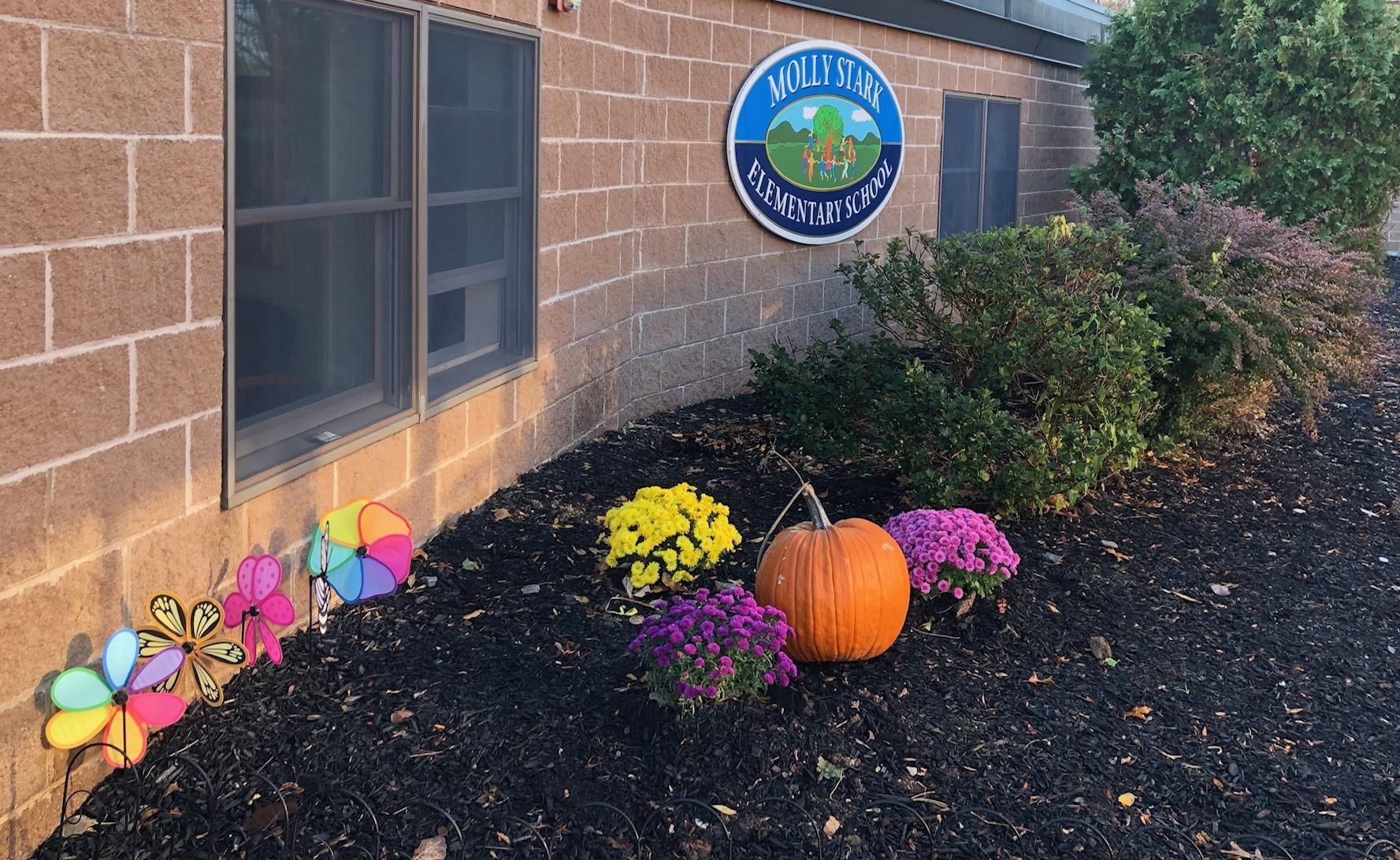 school sign at fall
