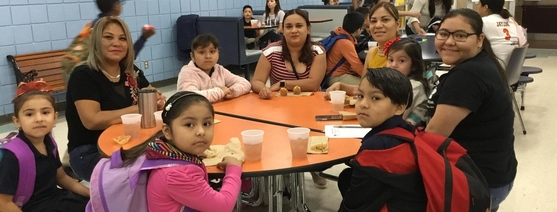 Image of family at Muffins with Mom Celebration