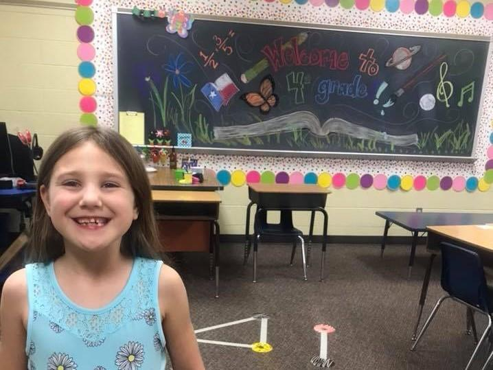 Student excited to see new classroom at Meet the teacher