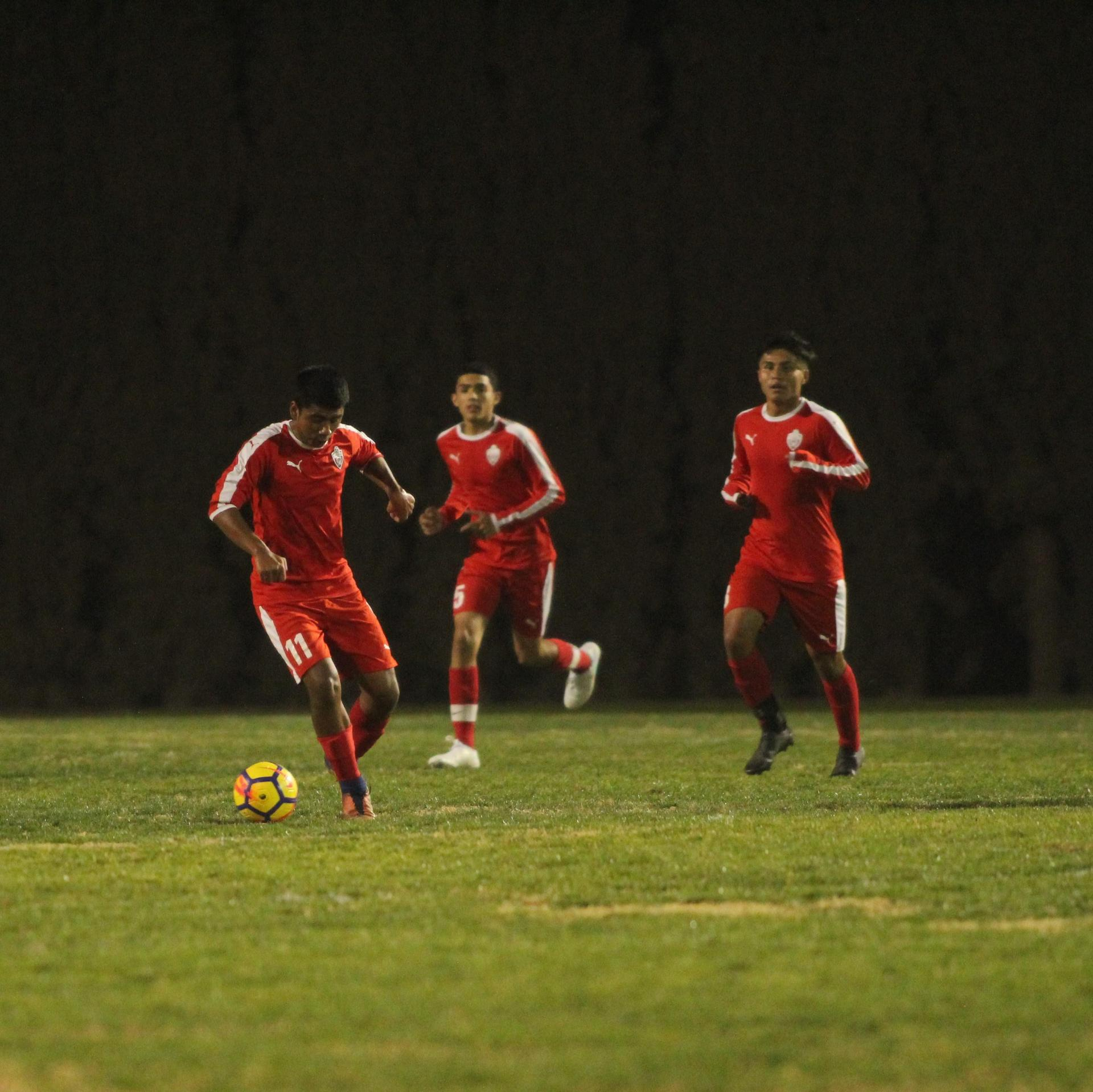 Cristobal Galvan, Edgar Campos and Favian Casillas with the ball
