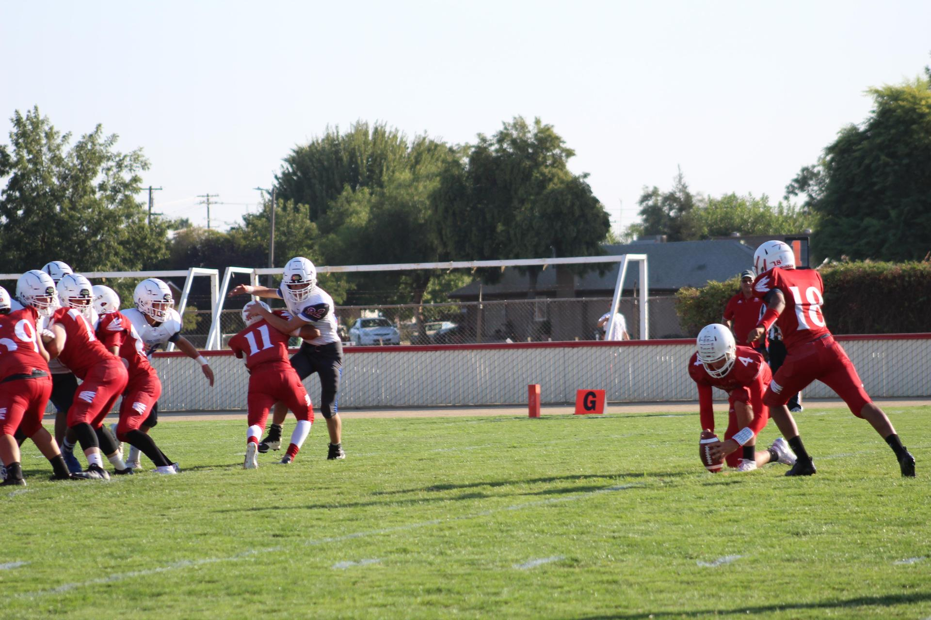 JV football players in action vs Immanuel