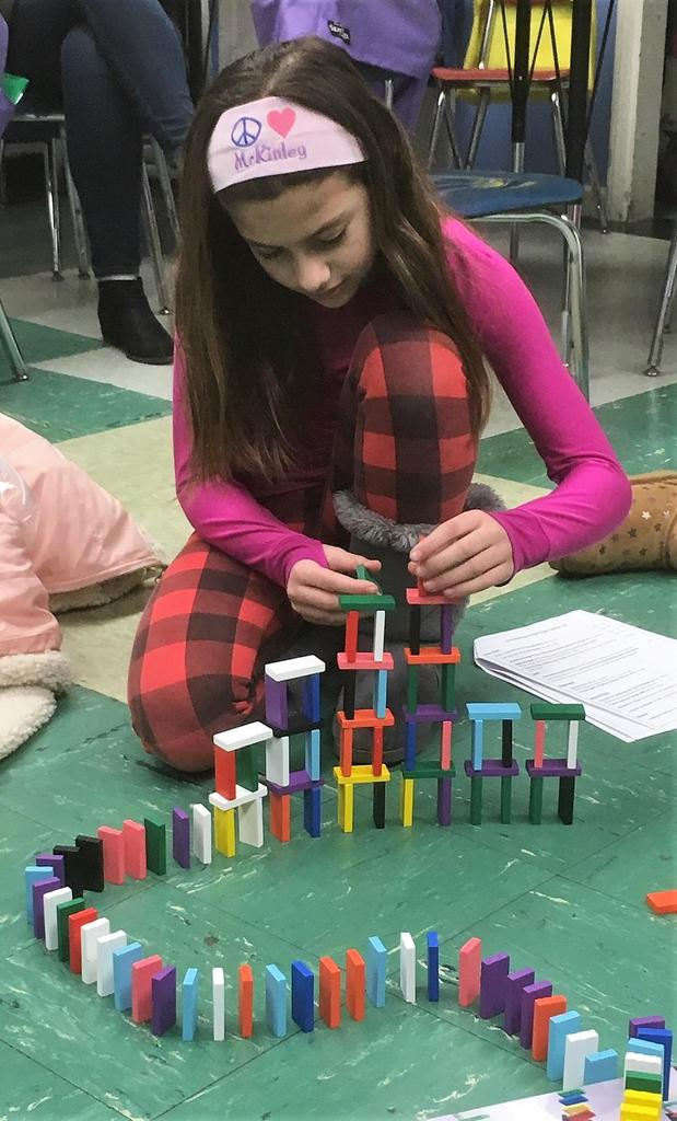 McKinley 4th grader Alyssa Katz created a domino chain reaction at STEM Night on Jan. 30.