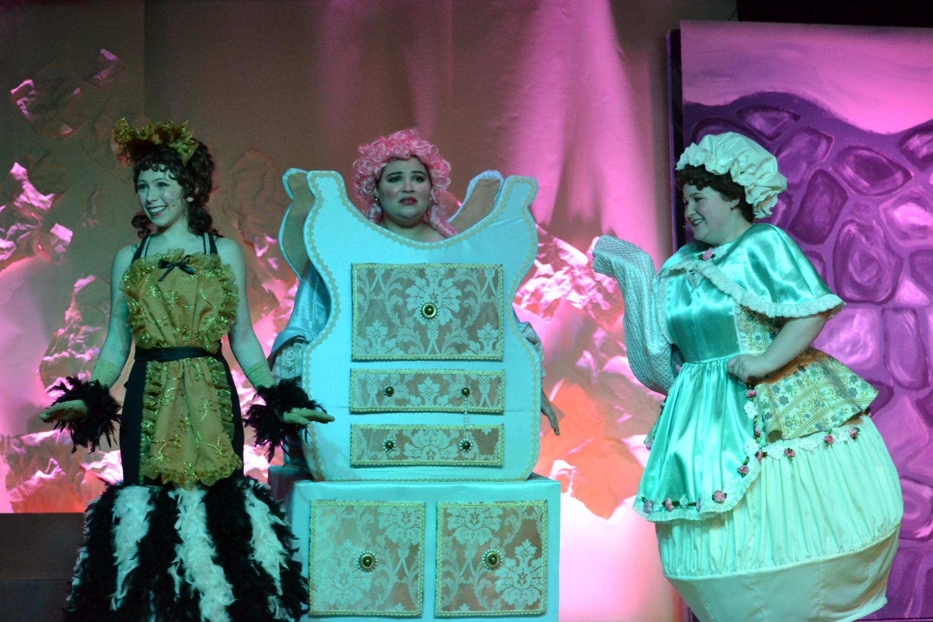 Babette (Alex), Madame de la Grande Bouche (Ganina), and Mrs. Potts (Alyssa) give Belle advice in the 2018 spring musical