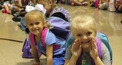 Kindergarten students sitting on floor