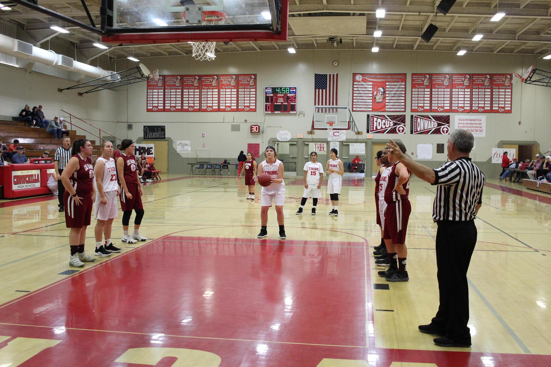 Junior Varsity girls playing basketball against Los Banos