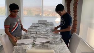 Zubin and Tenzing organizing materials for face shields