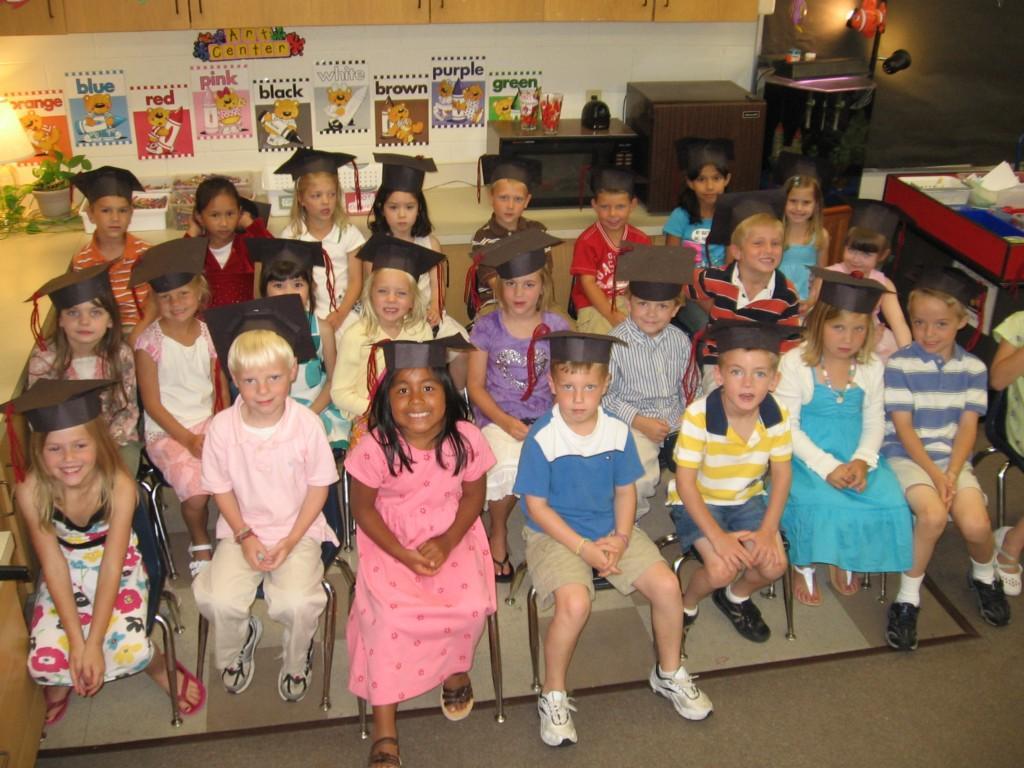 students pose in graduation caps