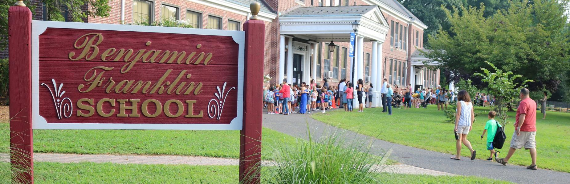 Students and their families arrive at Franklin School for the first days of a new school year.