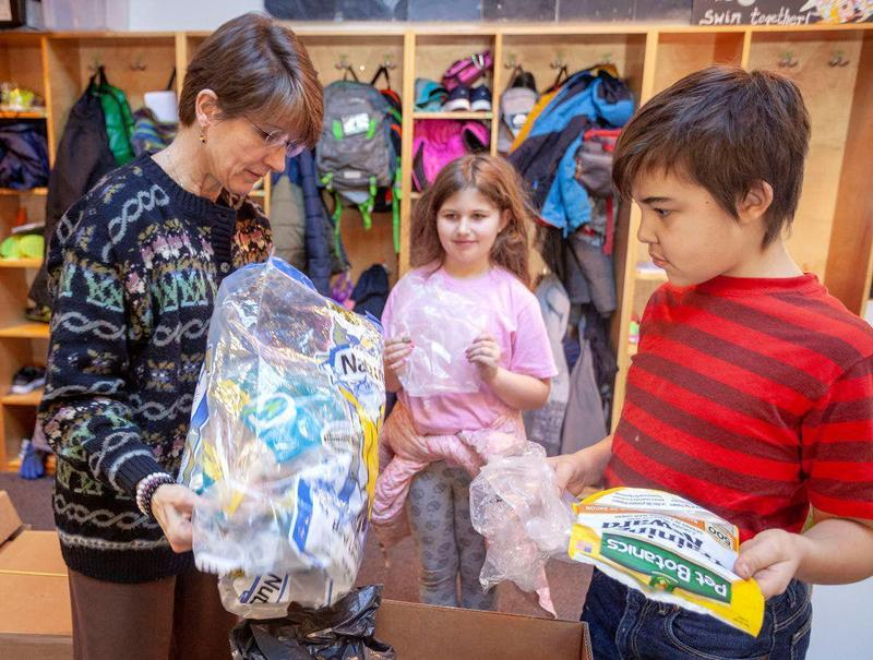 Mrs. Bonzo sorting plastic with 4th Grade Students