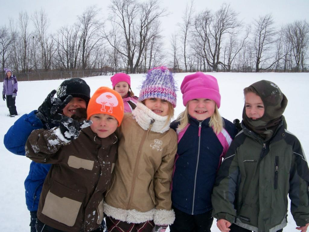 kids outside in snow at recess