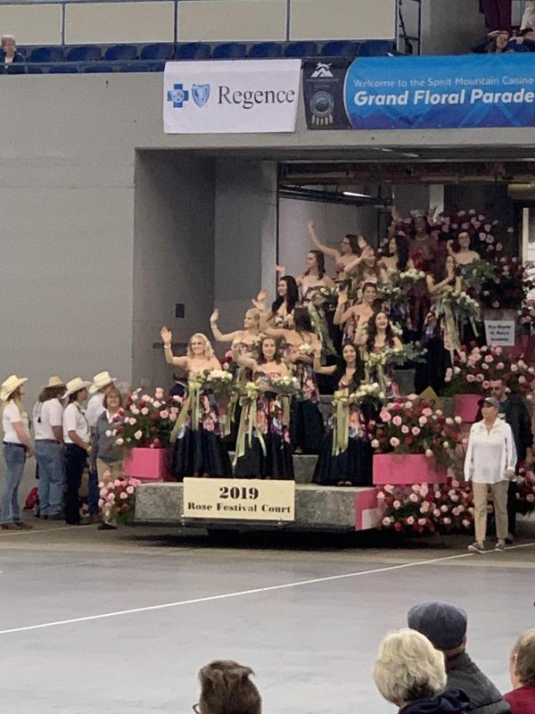 PEOPLE WAVING FROM PARADE FLOAT