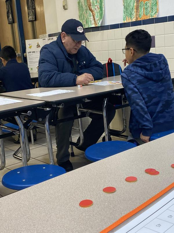 a boy and his grandfather working together to answer the math problem