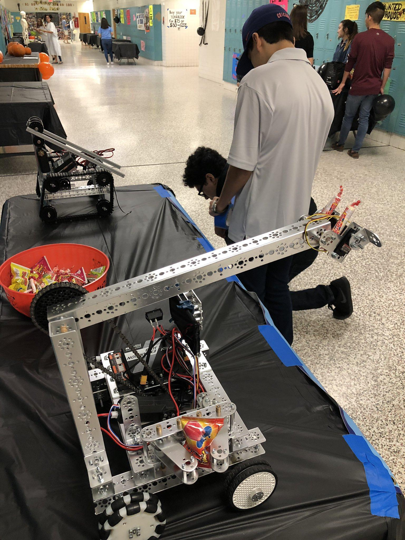 student working on a robotic arm