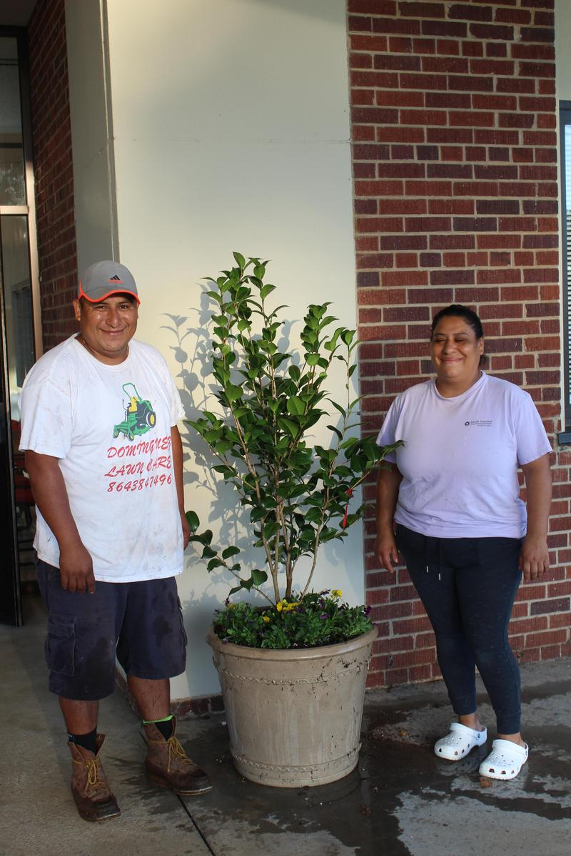 Parents with planters filled with new plants