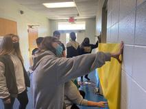 Students working on Christmas door decorations