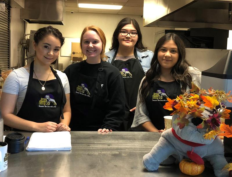 Female high school students working in the coffee concessions.