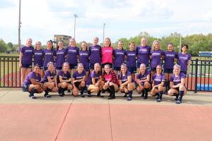 soccer team in their purple jerseys