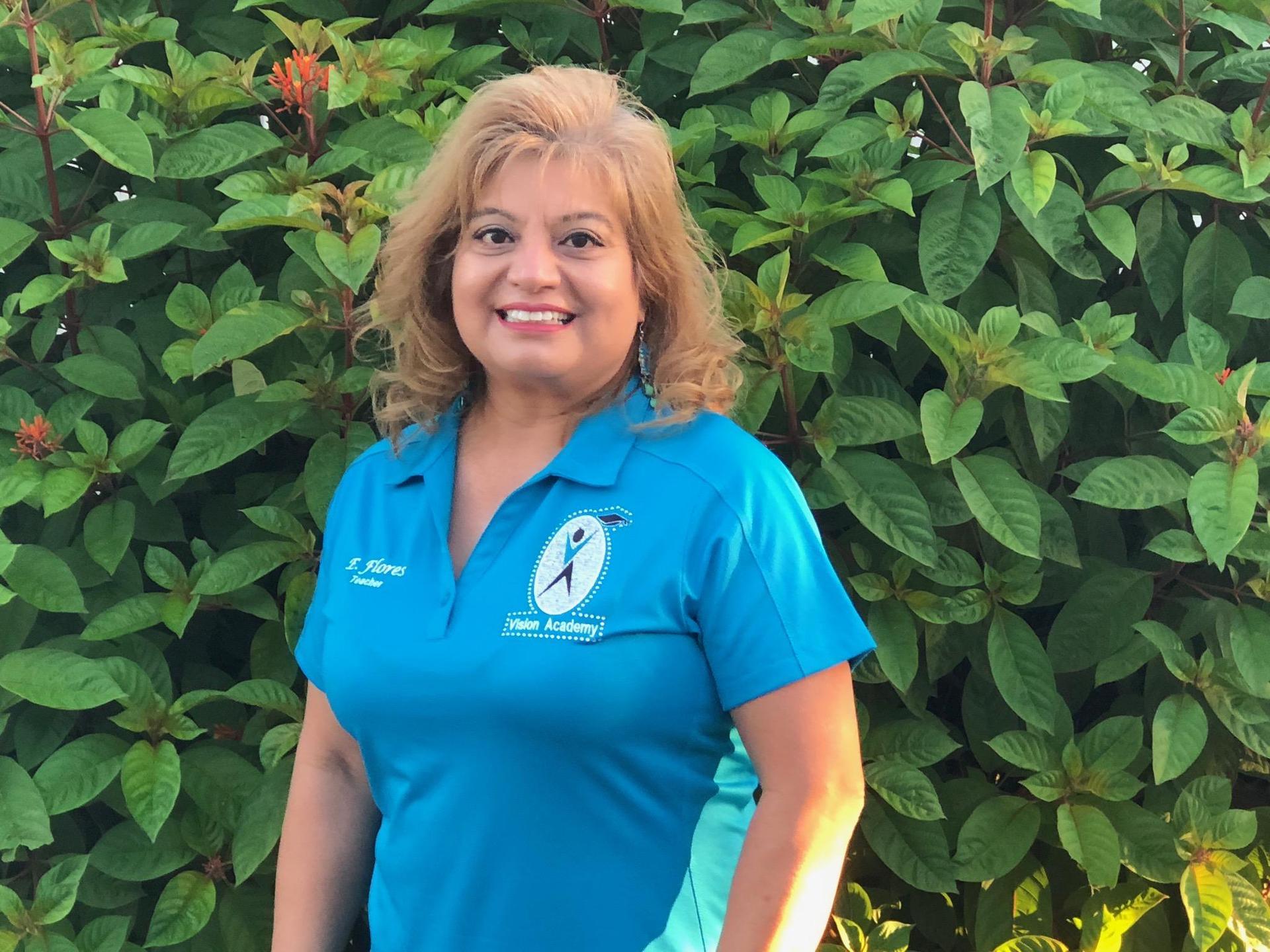 E. Flores English Teacher