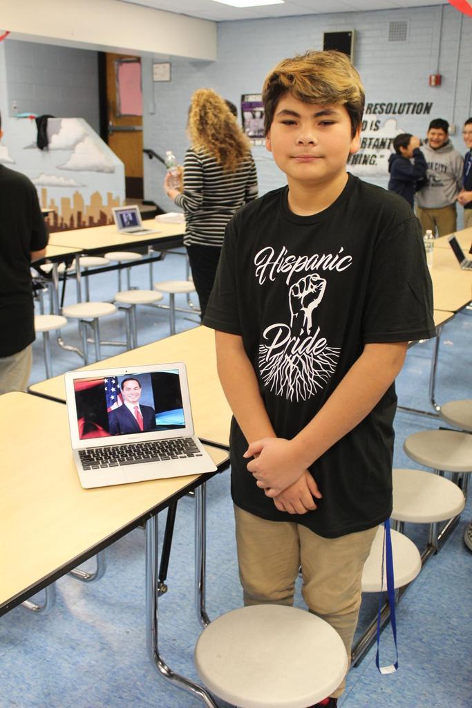 boy with presentation on hispanic american