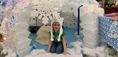 Girl in igloo