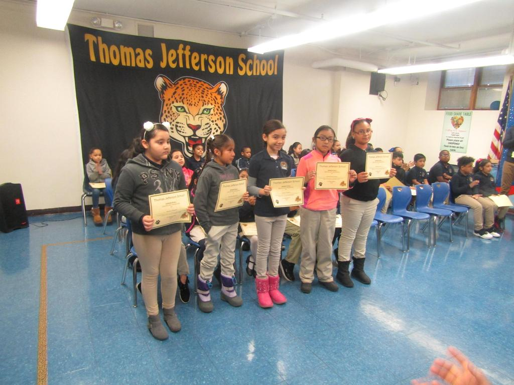 fourth group of honor roll recipients holding their certificates