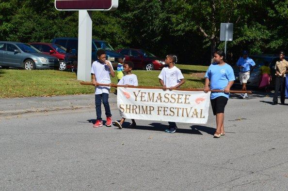 Students walk in Shrimp Festival