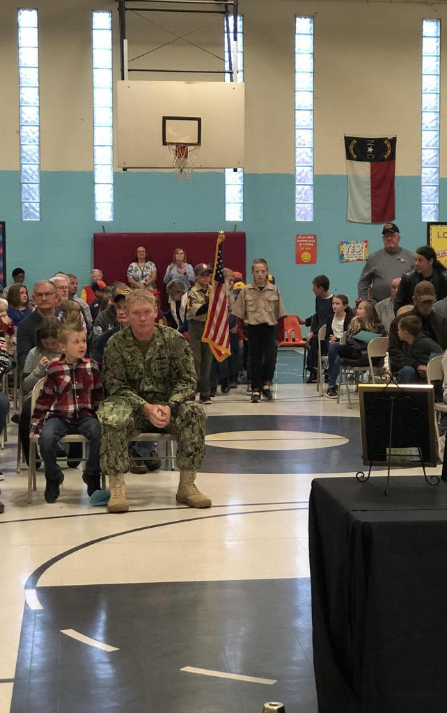 Scouts present the American flag at the RCES Veterans Day assembly