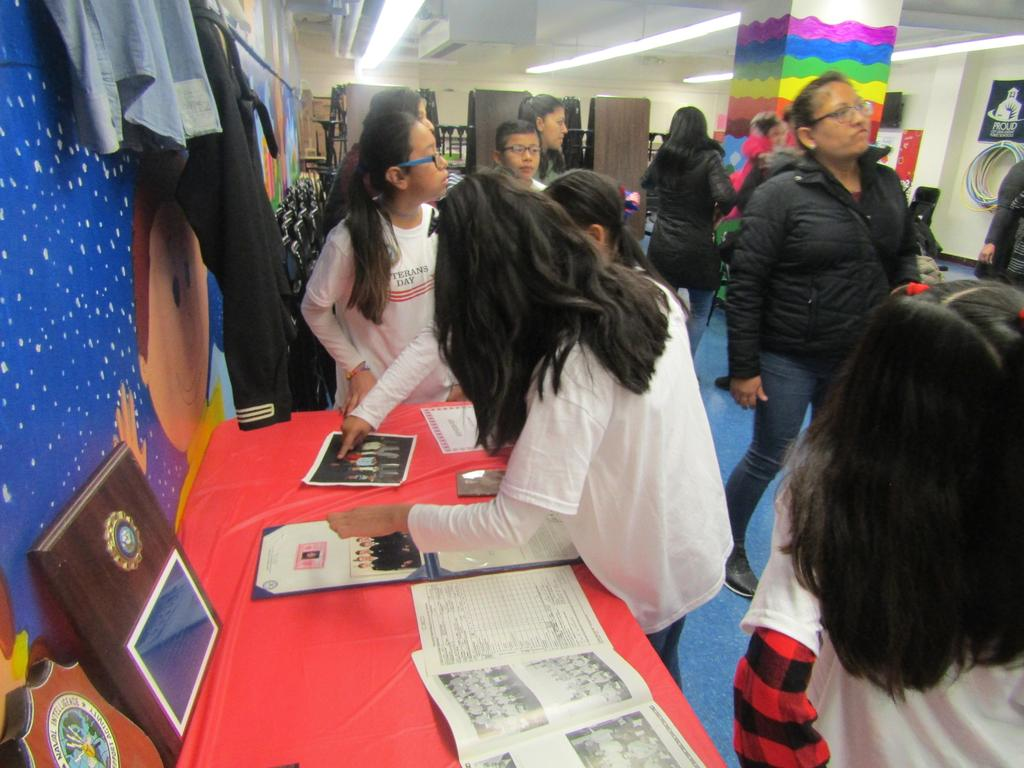 students looking at the displayed memorabilia table