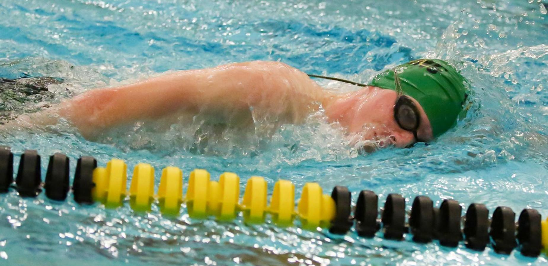 Student swims in competition
