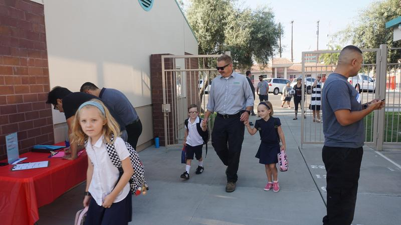 Parents and students arriving the first day of school