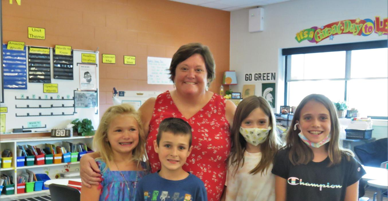 Lee Elementary teacher Mrs. Woods greets new students.
