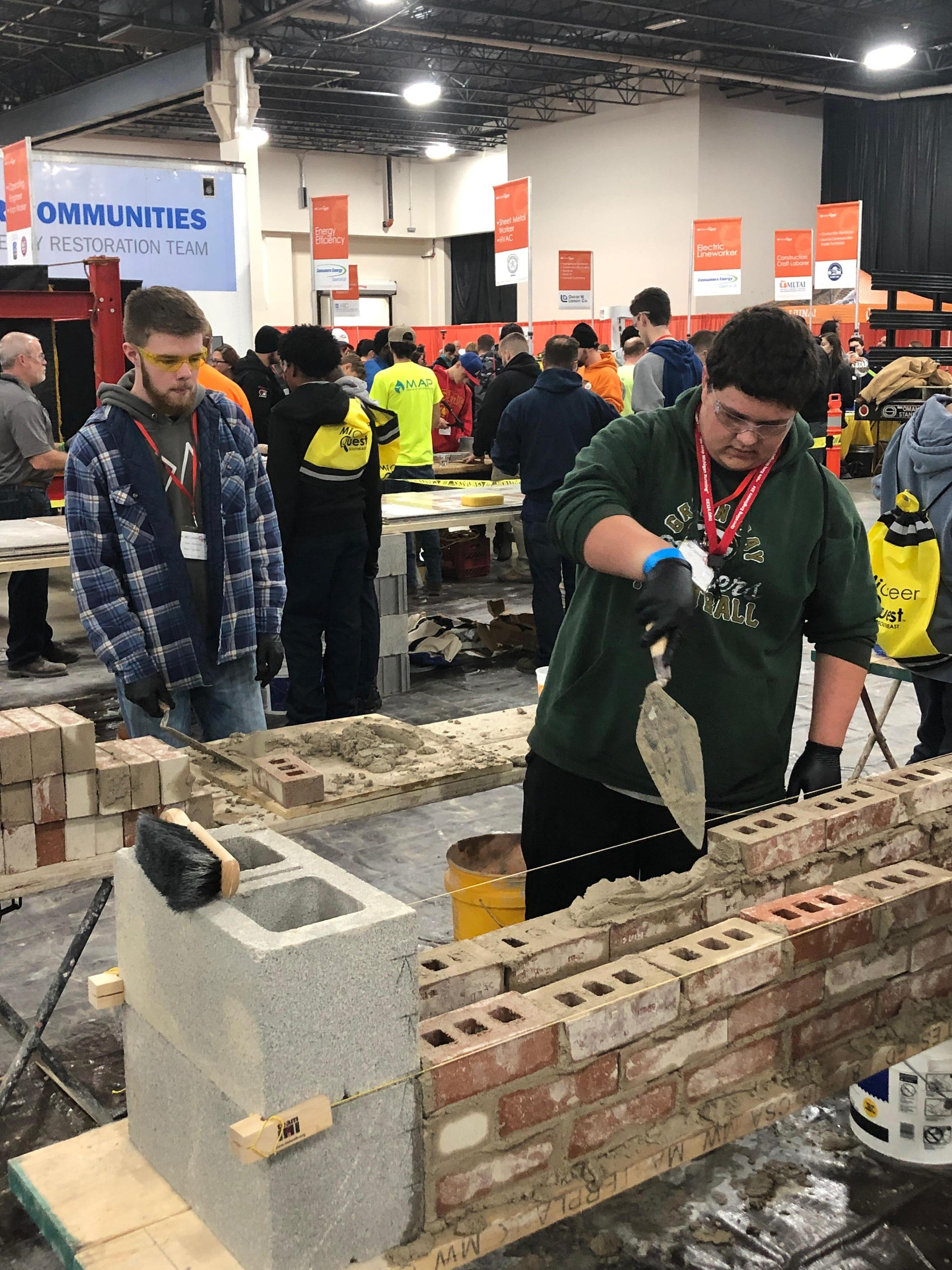Students trying bricklaying