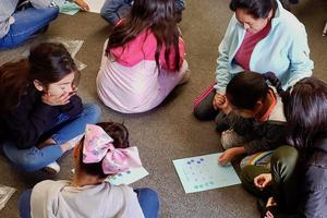 Students working with parents solving math problems