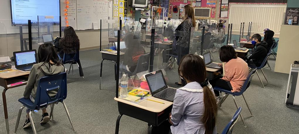 Students sit at their desks.