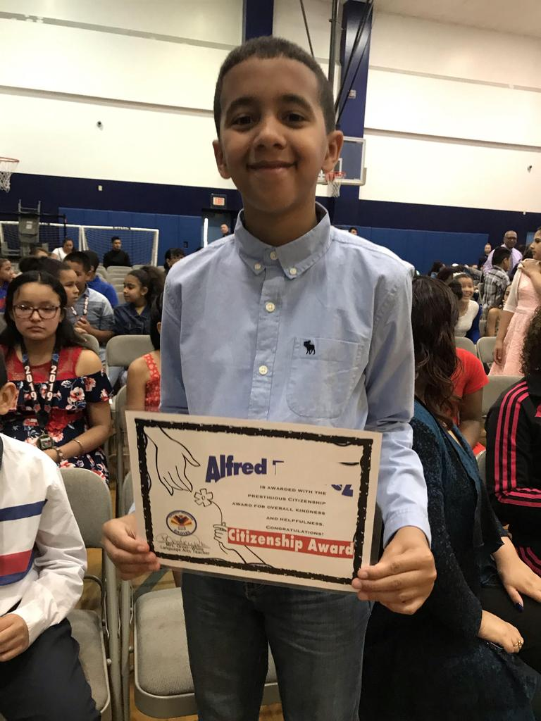 Alfred showing off his citizenship award