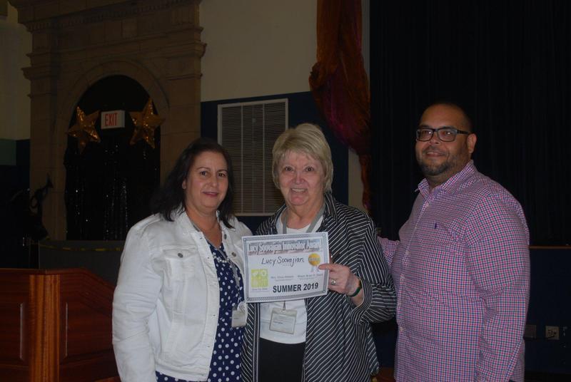Superintendent Abbato, Supervisor Soojaviian, and Navass with the Innovator Award
