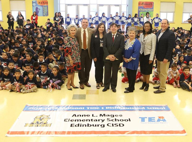 """Magee Elementary School students and staff celebrate the school's second national award during a special ceremony at the campus. Pictured standing L-R: ECISD School Board Member Dominga """"Minga"""" Vela, ECISD Superintendent Dr. René Gutiérrez, Magee Elementary School Principal Marla Cavazos, Congressman Vicente Gonzalez, ECISD School Board Vice President Carmen Gonzalez, Region 10 Title I Program Coordinator Lauren A. McKinney and ECISD School Board Member Miguel """"Mike"""" Farias."""