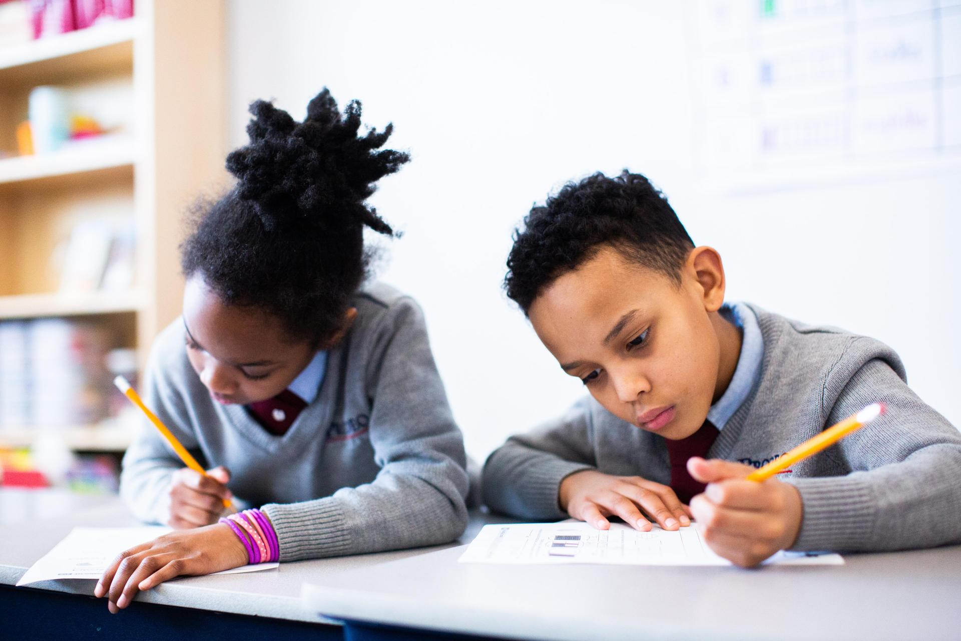 two students writing