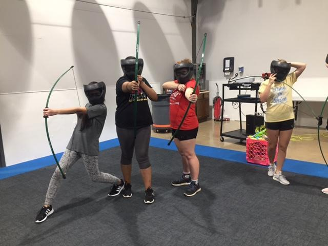 Students with bows and arrows