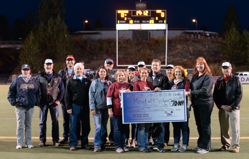 Picture of people receiving the check for the 2018 Cat Scramble event.