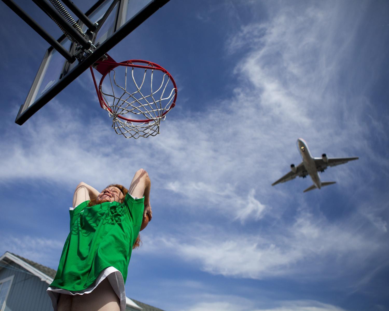 Lennox student shooting a basketball