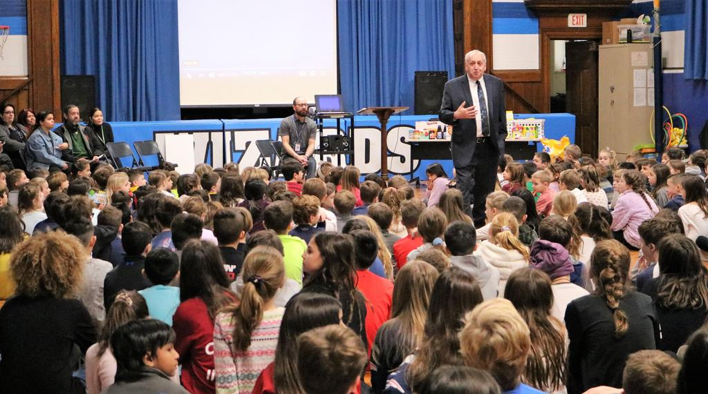 Photo of Wilson principal Joseph Malanga addressing students and staff during Month of Hope concluding assembly.