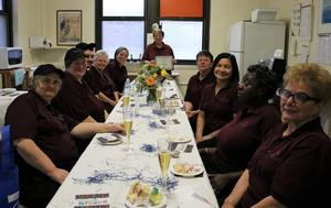 Anita Russo, who retired in December after more than 48 years as a cafeteria worker, poses with her cafeteria colleagues at a retirement party in December.