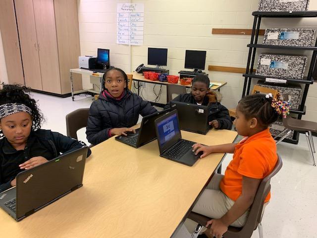 Students working on Chromebooks