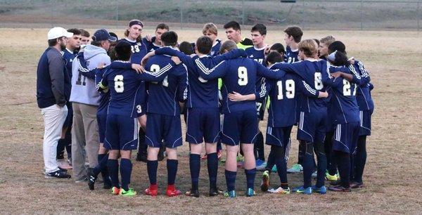 boys huddled together