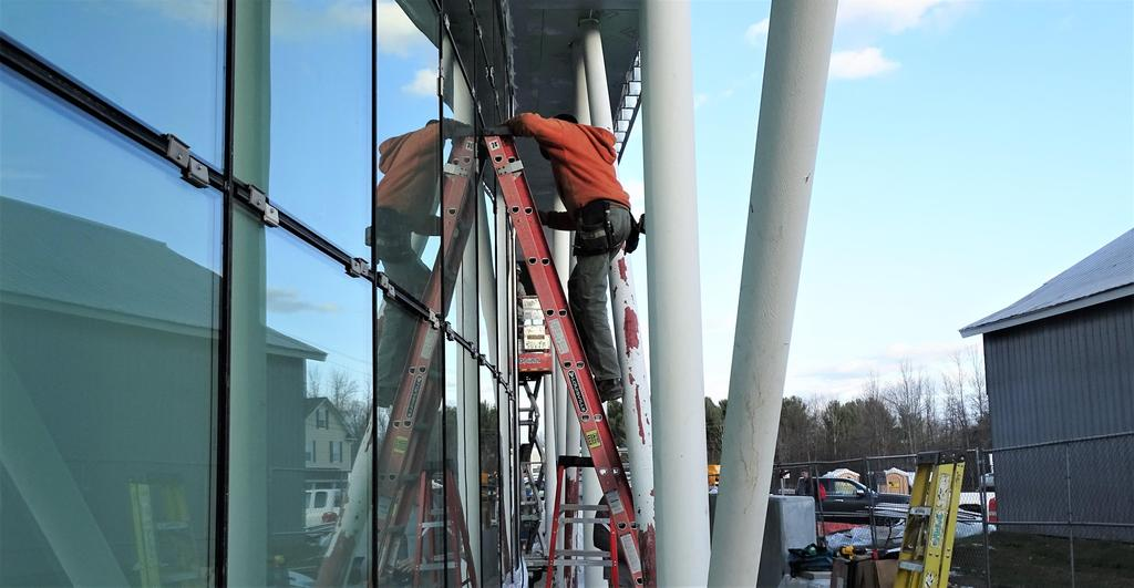 This snapshot shows Adams Glass crew members installing the large group instruction room's south-facing curtain wall featuring natural light through the glass panels, during the last week of November 2019.