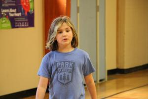 student walking in p.e.