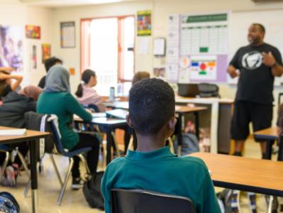 Teacher speaking to students