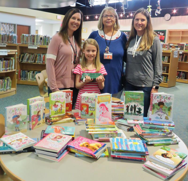 Third-grader Audrey Lee met her goal of reading 100 books during the school year. She is pictured with her teacher Char Thomas, Lee librarian Cindy Brooksand Lee Elementary Principal Angie Jefferson.