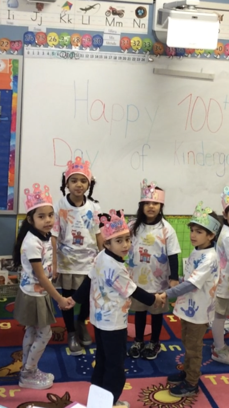group of children wearing crown and t-shirt with their hand prints